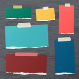 Pieces of white squared note paper sticked on brown wooden wall or desk Stock Image