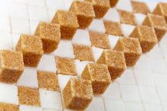 Pieces of white sugar Stock Photos
