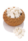 Pieces of white sugar cubes in a wicker basket Royalty Free Stock Photo
