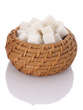 Pieces of white sugar cubes in a wicker basket Royalty Free Stock Images