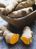 Pieces of Whole And Cracked Fresh Turmeric Root Stock Photo