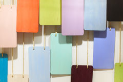 Pieces of wood with different colors hanging on the wall Stock Image