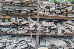 Pieces of wood in factory, Wooden boards in a warehouse of building materials Royalty Free Stock Images