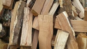 Pieces of wood wood pile in the yard stock footage