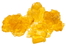 Pieces of yellow crystal caramel sugar Stock Images