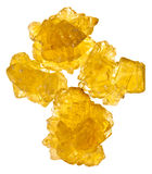 Pieces of yellow crystalline sugar Stock Image