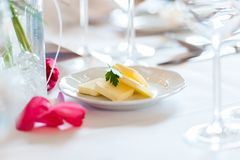 Pieces of butter on small plate on table royalty free stock photos
