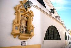 Piedad Del Baratillo gegen Wand, Sevilla, Spanien Lizenzfreies Stockfoto
