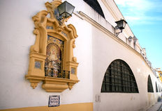 Piedad del Baratillo tegen muur, Sevilla, Spanje Royalty-vrije Stock Foto
