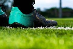 Piede di un calcio o di un giocatore di football americano Fotografia Stock