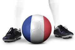 Piede e pallone da calcio con una bandiera della Francia Fotografie Stock Libere da Diritti