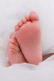 Piedi del bambino su bianco Fotografie Stock Libere da Diritti