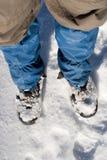 Piedi dentro a neve fotografia stock