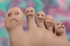 Piedi di piede di sofferenza infelici delle dita del piede fotografia stock