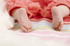 Piedi nudi del bambino del primo piano Fotografia Stock