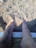 Piedi in sabbia Immagine Stock