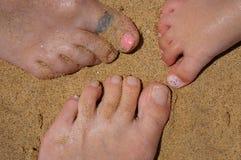 Piedi sulla spiaggia Immagini Stock