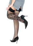 Piedini della donna in calze nere. Immagine Stock Libera da Diritti