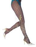 Piedini lunghi della donna in dancing-pistoni bianchi fotografia stock libera da diritti
