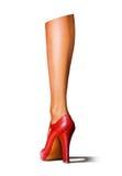 Piedino della donna con un pattino high-heeled rosso Fotografie Stock Libere da Diritti