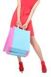 Piedino e sacchetto della donna di acquisto Immagine Stock