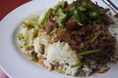 Piedino stufato del porco su riso Fotografia Stock
