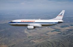 Piedmont Air Lines Boeing B-737 in flight over South Carolina in 1985 royalty free stock photo