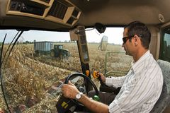 Viewpoint of the driver of the combine on the corn field Stock Photography