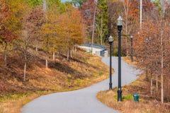 Piedmont Park trail, Atlanta, USA. Beautiful autumn landscape with Piedmont Park Trail and multicolor trees, Atlanta, USA Stock Photography