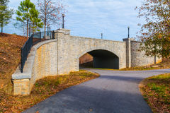 Piedmont Park Trail and stone bridge, Atlanta, USA Royalty Free Stock Photo