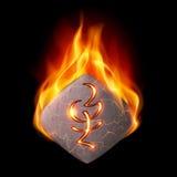 Piedra ardiente con la runa mágica Fotografía de archivo libre de regalías