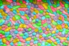 Piedra colorida, fondo, textura Brillante, rojo, verde, azul, anaranjado, amarillo, papeles pintados Fotografía de archivo
