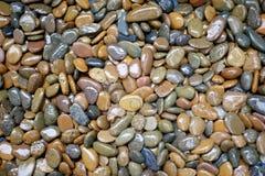 Piedra colorida y mojada fotografía de archivo