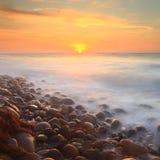 El adoquín empiedra puesta del sol Imagenes de archivo