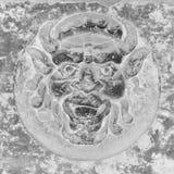 Piedra del diablo en la pared Imagenes de archivo