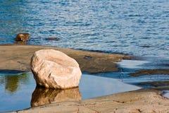 Piedra en el lago Foto de archivo libre de regalías