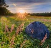 Piedra en la puesta del sol Imagenes de archivo