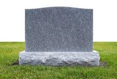 Piedra grave en hierba verde Imagen de archivo libre de regalías