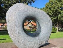 Piedra gris con el agujero Fotografía de archivo