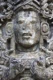 Piedra maya de la cara que talla el sitio arqueol?gico Honduras de Copan Ruinas imagen de archivo