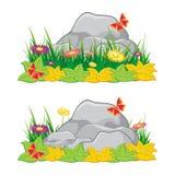 Piedra - roca con la hierba verde, la flor y la mariposa Foto de archivo libre de regalías