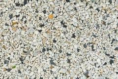 Piedra y garvel en el cierre de tierra encima de la textura de la superficie del detalle Foto de archivo libre de regalías
