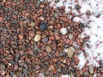 Piedra y nieve Imágenes de archivo libres de regalías