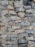 piedras ásperas naturales apiladas pared del fondo Imagen de archivo