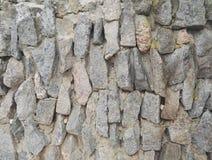 piedras ásperas naturales apiladas pared del fondo Fotografía de archivo libre de regalías