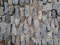 piedras ásperas naturales apiladas pared del fondo Imagen de archivo libre de regalías