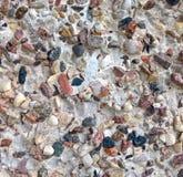 Piedras coloreadas en la pared E Imagenes de archivo