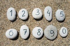 Piedras con el fondo de la arena Fotos de archivo libres de regalías
