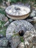 Piedras de molino viejas Imágenes de archivo libres de regalías