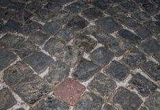 piedras de pavimentación grises del modelo del fondo en invierno Foto de archivo